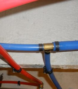 Color_Coded_Plumbing_Pex_Pipe_Close-Up_5-12-10_043.132200725_large